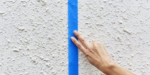 Applying Tape to Wall